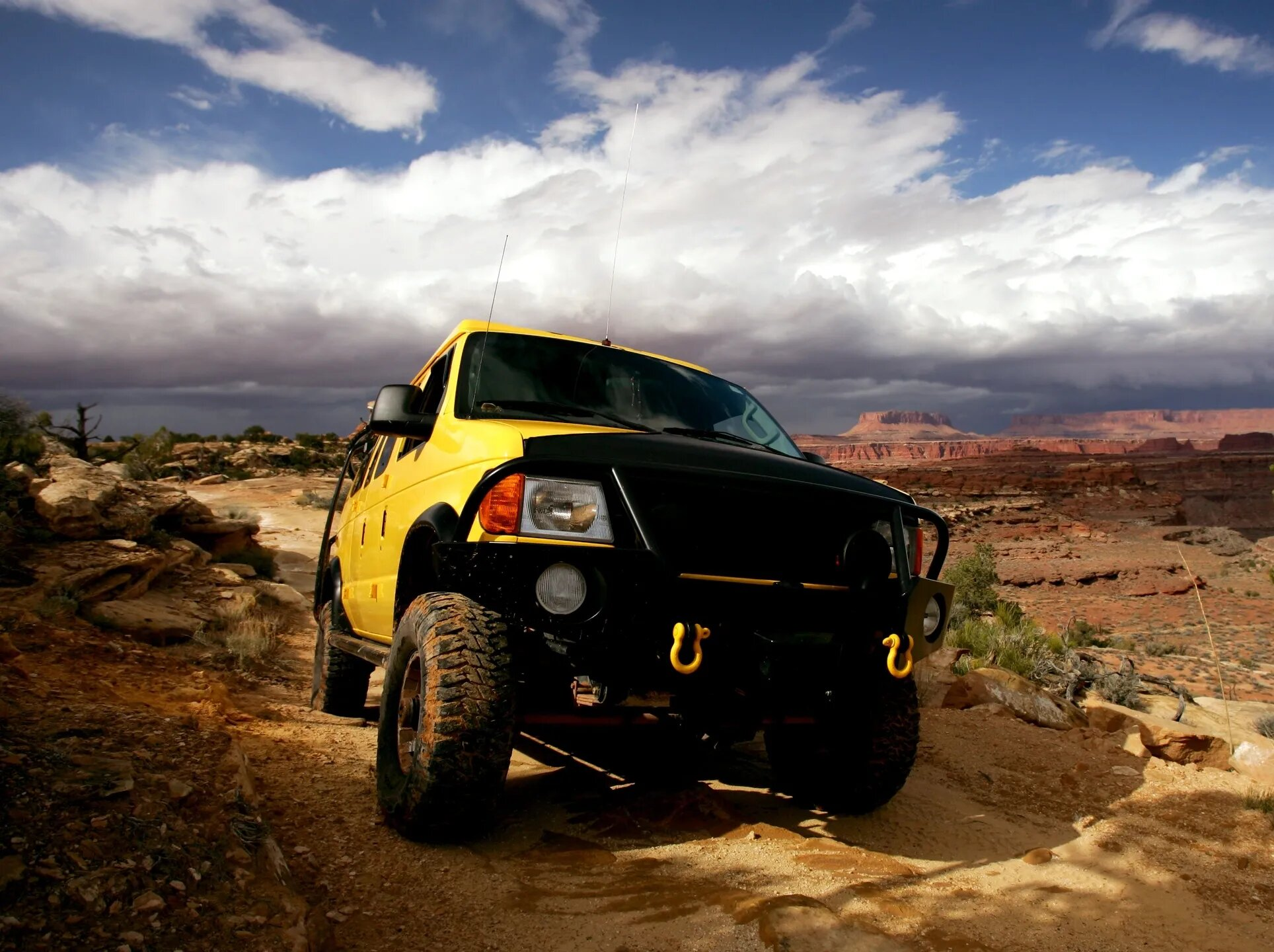 yellow truck on rough terrain